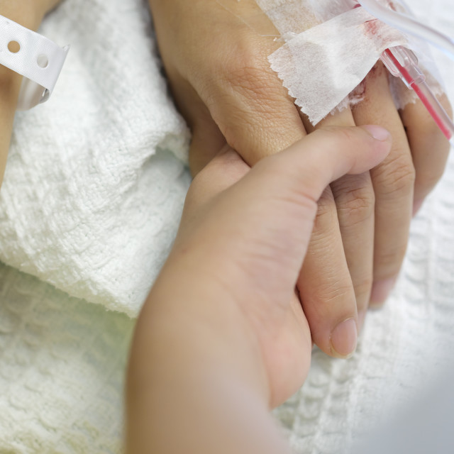 """""""Kid Holding Hand of Hospitalised Patient With IV Drip"""" stock image"""