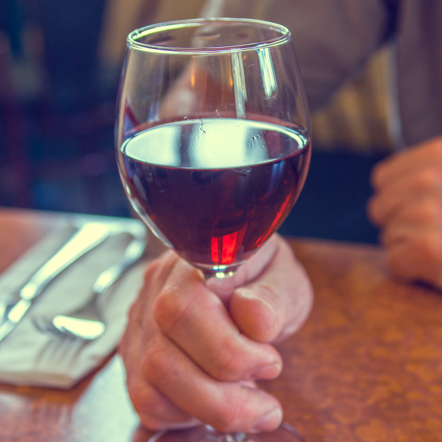 """""""Holdihg a glass of red wine"""" stock image"""