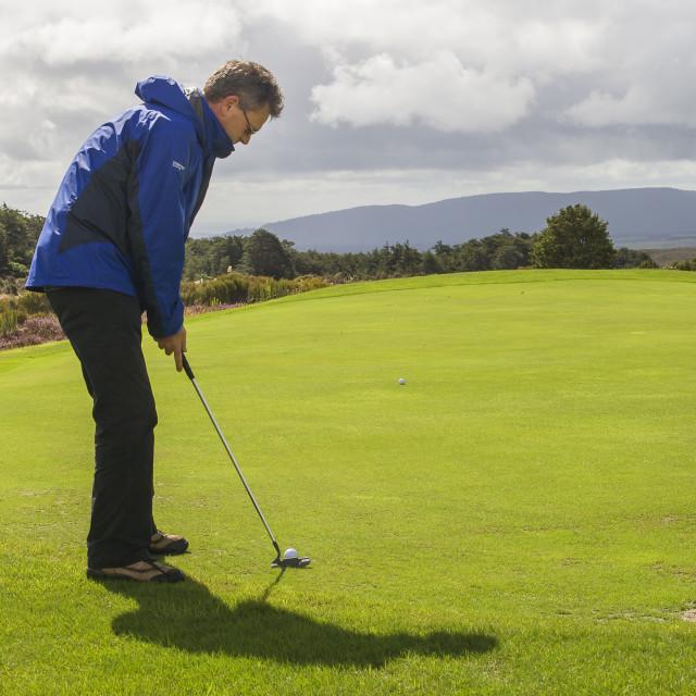 """""""Man playing golf"""" stock image"""