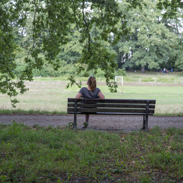 """close up on lonely woman on the bench"" stock image"