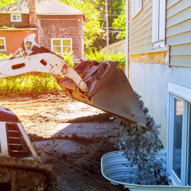 """Dredge loads a rubble against loader dumping gravel"" stock image"