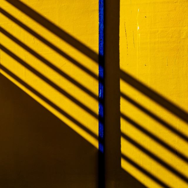"""Shadows on yellow"" stock image"