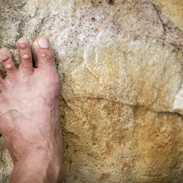 """Foot Stepping Onto Boulder"" stock image"