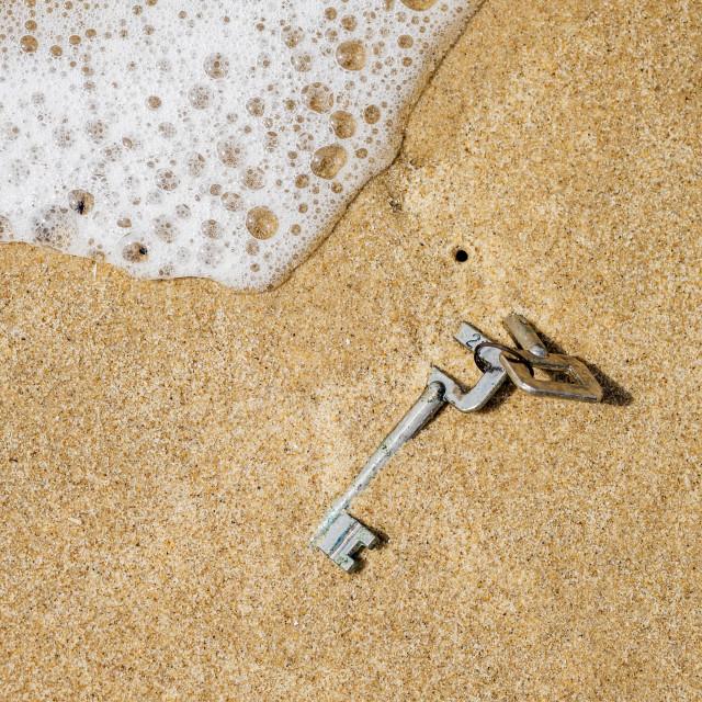 """Half-Buried Keys in Beach Sand"" stock image"