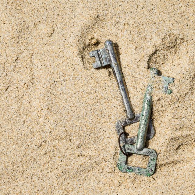 """""""Old Keys in Sand"""" stock image"""