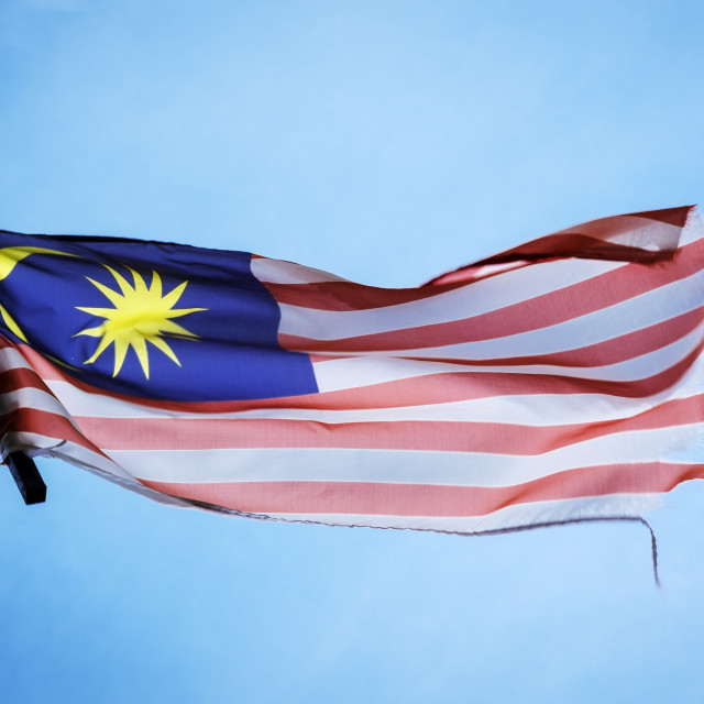 """Tattered Malaysian Flag Flying In The Air"" stock image"