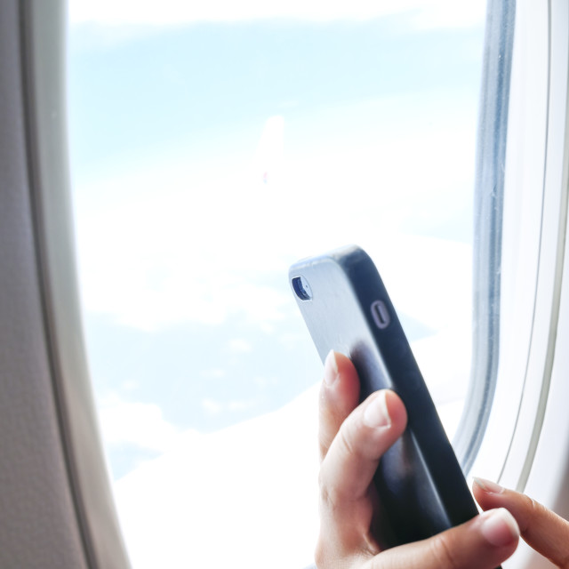 """Using Mobile Phone On Board Airplane"" stock image"