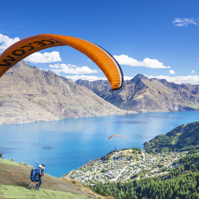 """Tandem Paragliding, from Bob's peak above Lake Wakatipu, Queenstown, South..."" stock image"