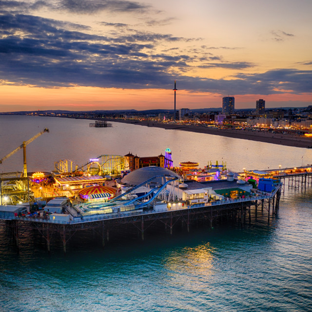 """The sun sets over Brightons Palace Pier"" stock image"