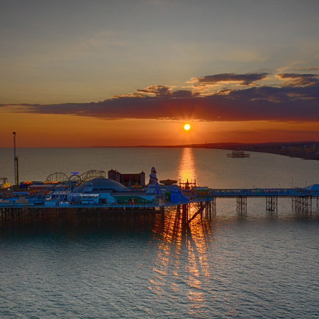 """The sun sets over Brightons Palace Pier."" stock image"
