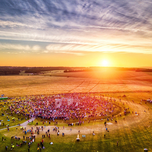 """The sun rises across Stonehenge on the Summer Solstice"" stock image"