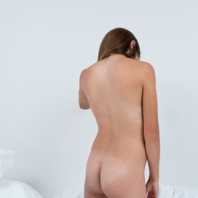"""Judit :: Naked in Bed"" stock image"