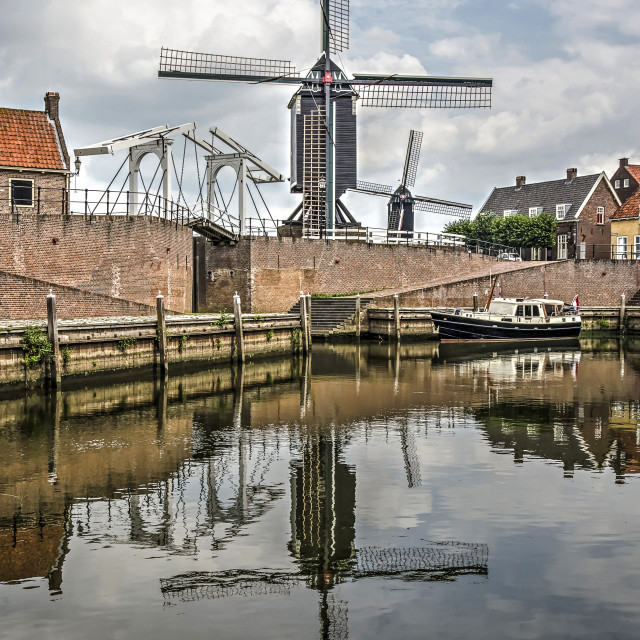 """""""Windmills and drawbridge reflecting in the harbour"""" stock image"""