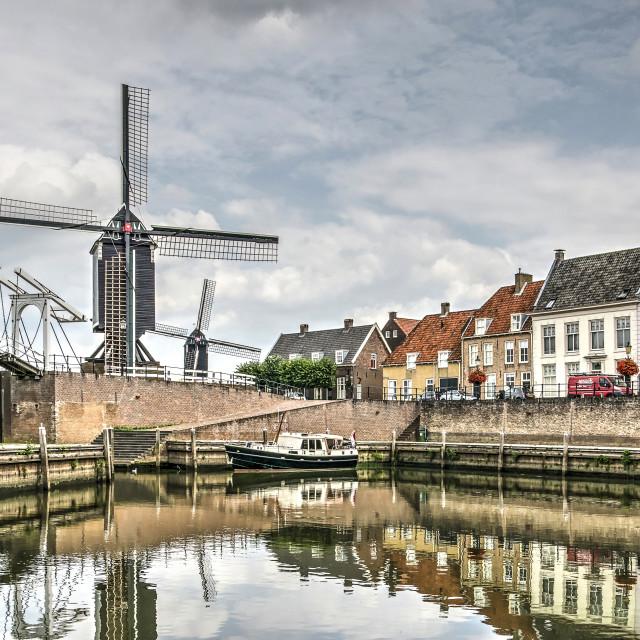 """Drawbridge, windmills and historic houses"" stock image"