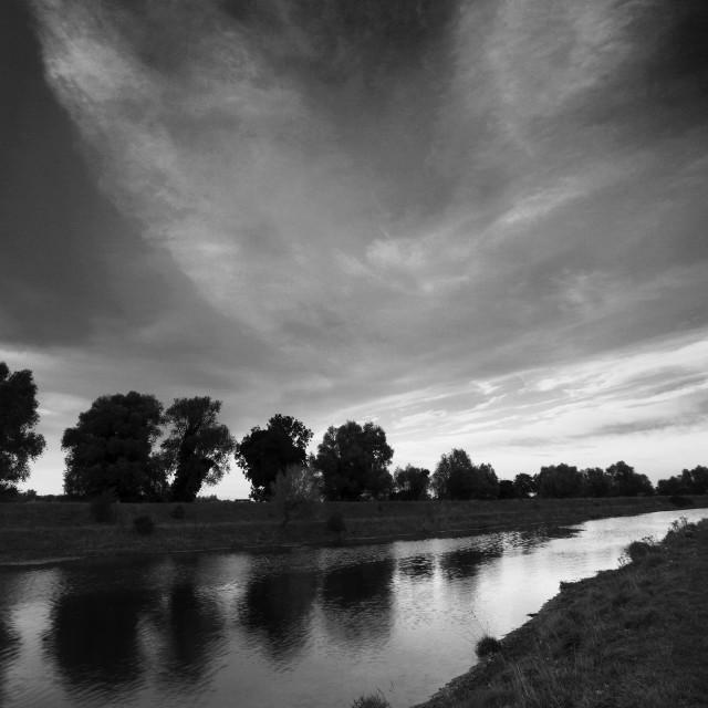 """Sunrise over Fenland drain waterway, Peakirk village, Cambridgeshire,..."" stock image"