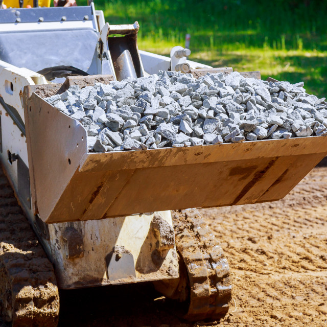 """""""Wheel excavator with hydraulic which is folded into transport loader dumping..."""" stock image"""