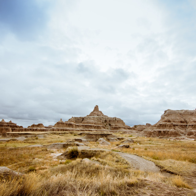 """Hiking through Badlands National Park"" stock image"
