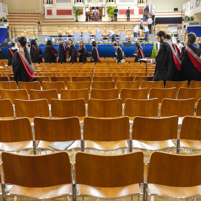 """Graduate students leaving university hall"" stock image"