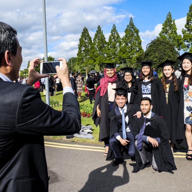 """Graduates Poses For Photo"" stock image"