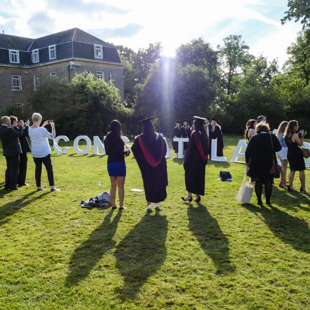 """University Graduates Posing For Photos"" stock image"