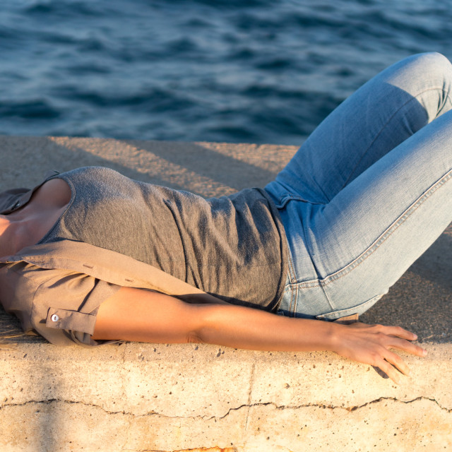 """""""Emma :: Laying in the Sun"""" stock image"""