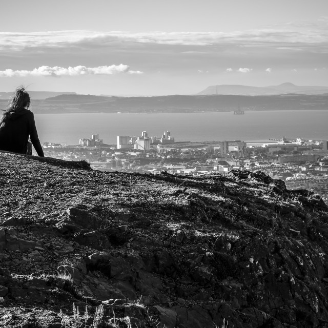 """People sitting atop of Arthurs Seat"" stock image"