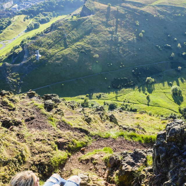 """Lone Woman Sitting Atop Arthur's Seat"" stock image"