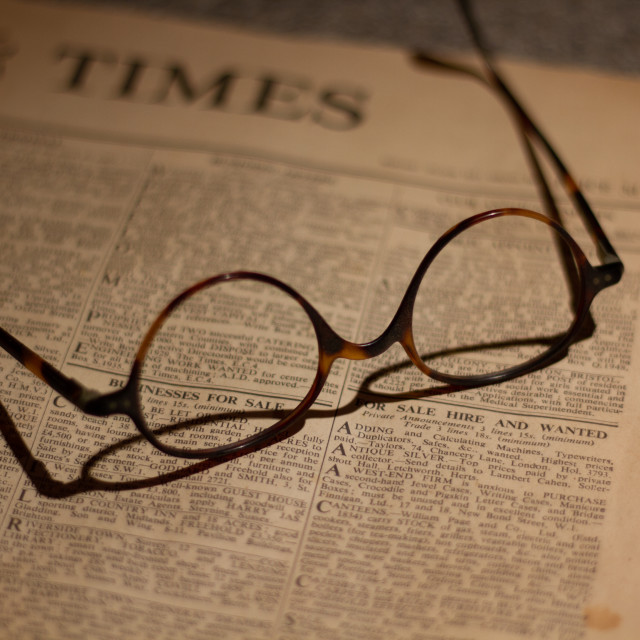 """Glasses and the Financial Times"" stock image"