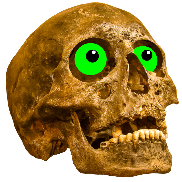 """A composite of a human skull with green Halloween eyes"" stock image"