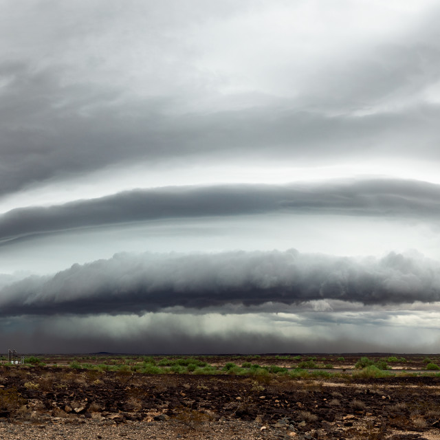 """Panoramic view of a dramatic shelf cloud ahead of a powerful storm."" stock image"