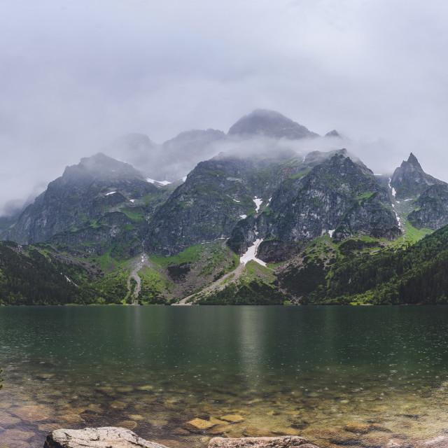 """View on Tatra mountains from Morskie Oko, Poland, heavy fog"" stock image"