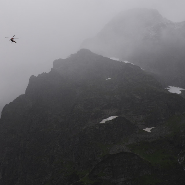 """rescue helicopter in the mountains, heavy fog, Tatra"" stock image"