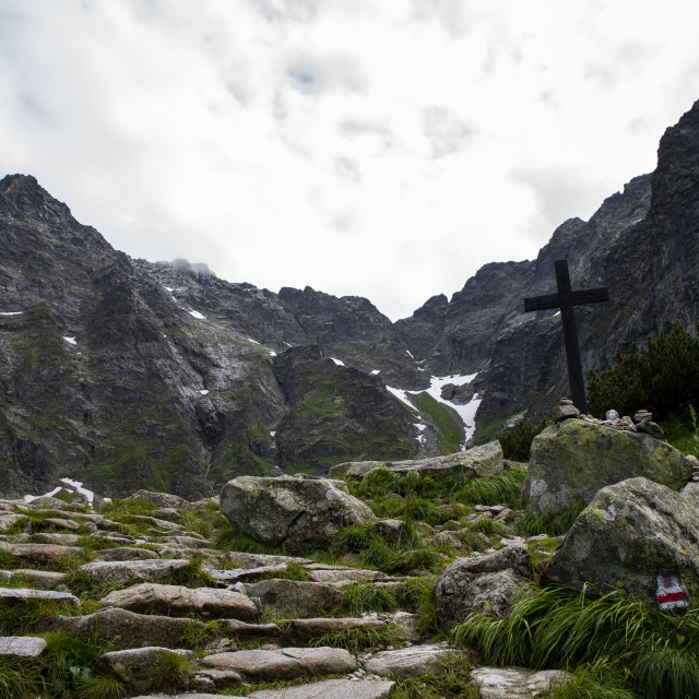 """cross on the Czarny Staw lake in Tatra Mountains"" stock image"