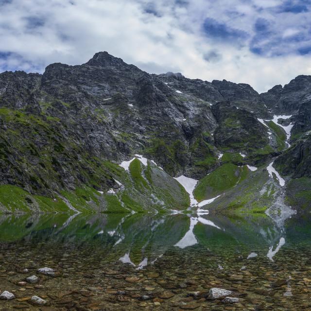 """Panorama vien of the Rysy i Tatra Mountains and the Czarny Staw Lake"" stock image"