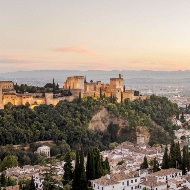 """Andalusian city of Granada, with the Alhambra palace on the hills at sunset, Andalusia, Spain."" stock image"