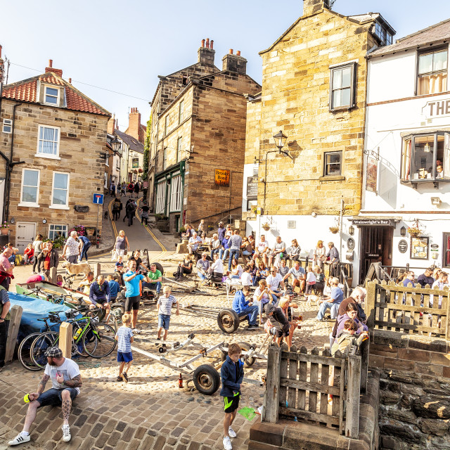 """""""people outside pub at Robin Hoods bay, Whitby"""" stock image"""
