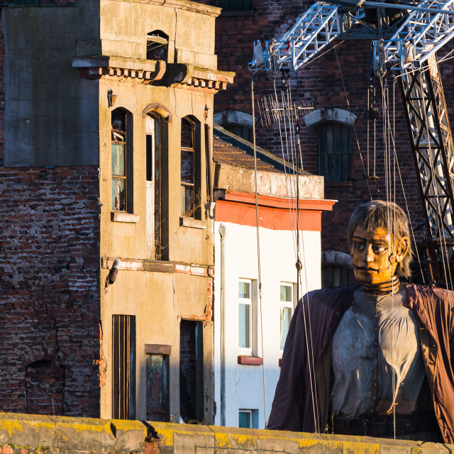 """Giant man towers above the wall which surrounds Clarence Dock"" stock image"