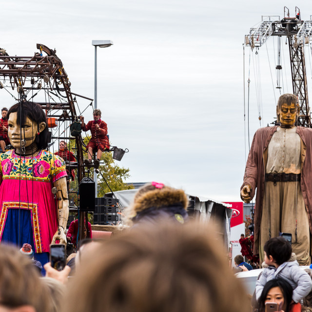 """Giant little girl leads the giant man into Liverpool for their finale"" stock image"