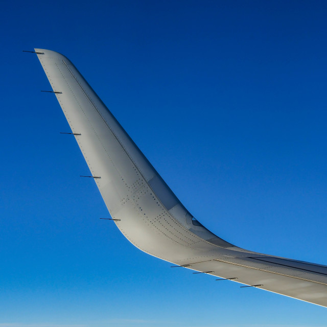 """""""Wing tip of a passenger jet"""" stock image"""
