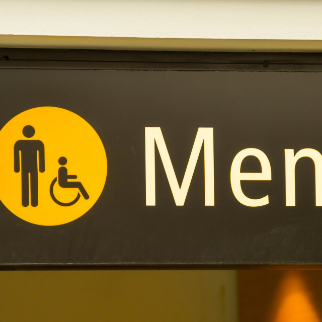"""""""Illuminated sign in airport for men's toilet"""" stock image"""