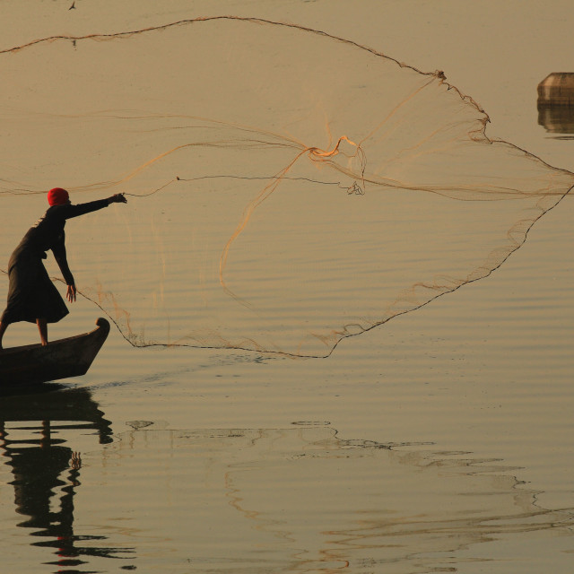 """fisherman in action throwing his fishing net"" stock image"