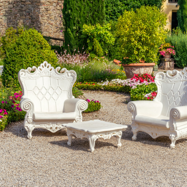 """""""Two big plastic armchairs with white color placed in Tuscany garden"""" stock image"""