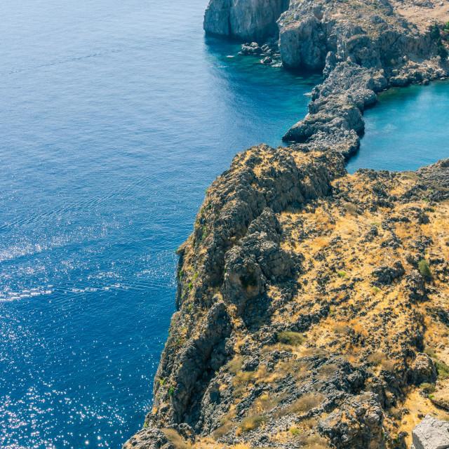 """""""Rocky reef under Lindos acropolis on Rhodos island"""" stock image"""