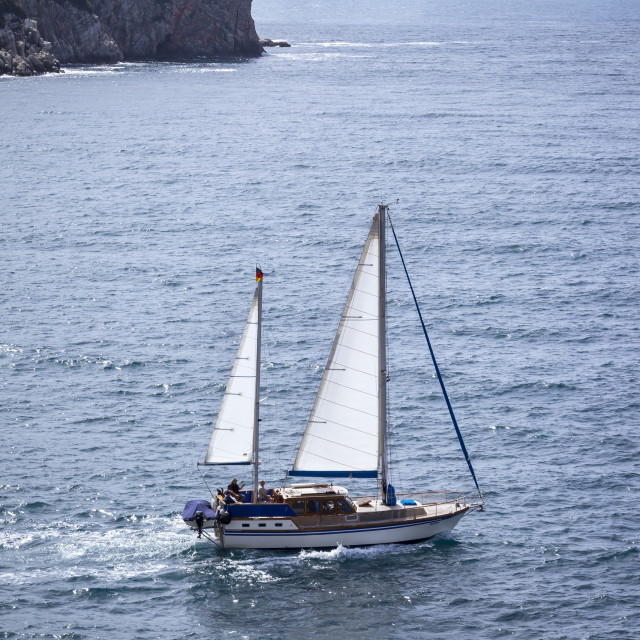 """""""View of a yacht that crosses Lokrum island"""" stock image"""