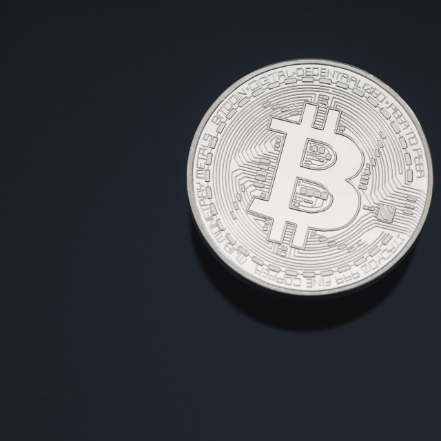 """Bitcoin cryptocurrency coin token close up cleaned silver macro with black background and copy space selective focus."" stock image"