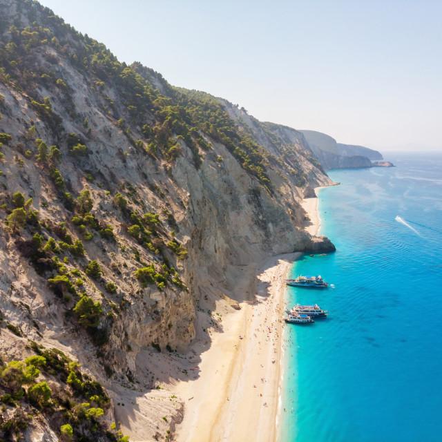 """Tourist ship on the Egremni beach, Lefkada, Greece."" stock image"