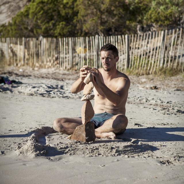 """stone balancing on the beach"" stock image"