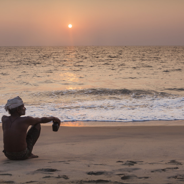 """""""a man sit on the beach"""" stock image"""