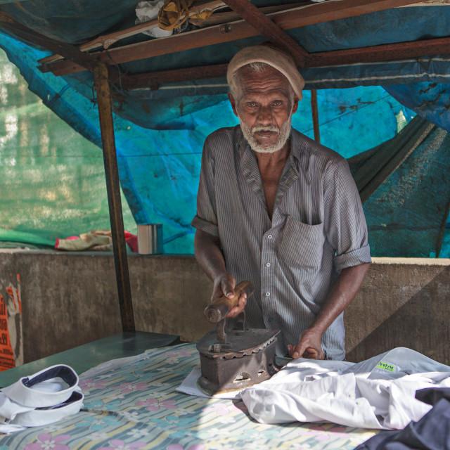 """man ironing clothes"" stock image"