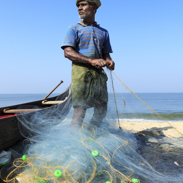 """fisherman preparing his nets"" stock image"